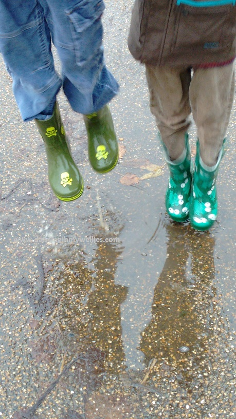 Jumping in puddles wearing wellies!